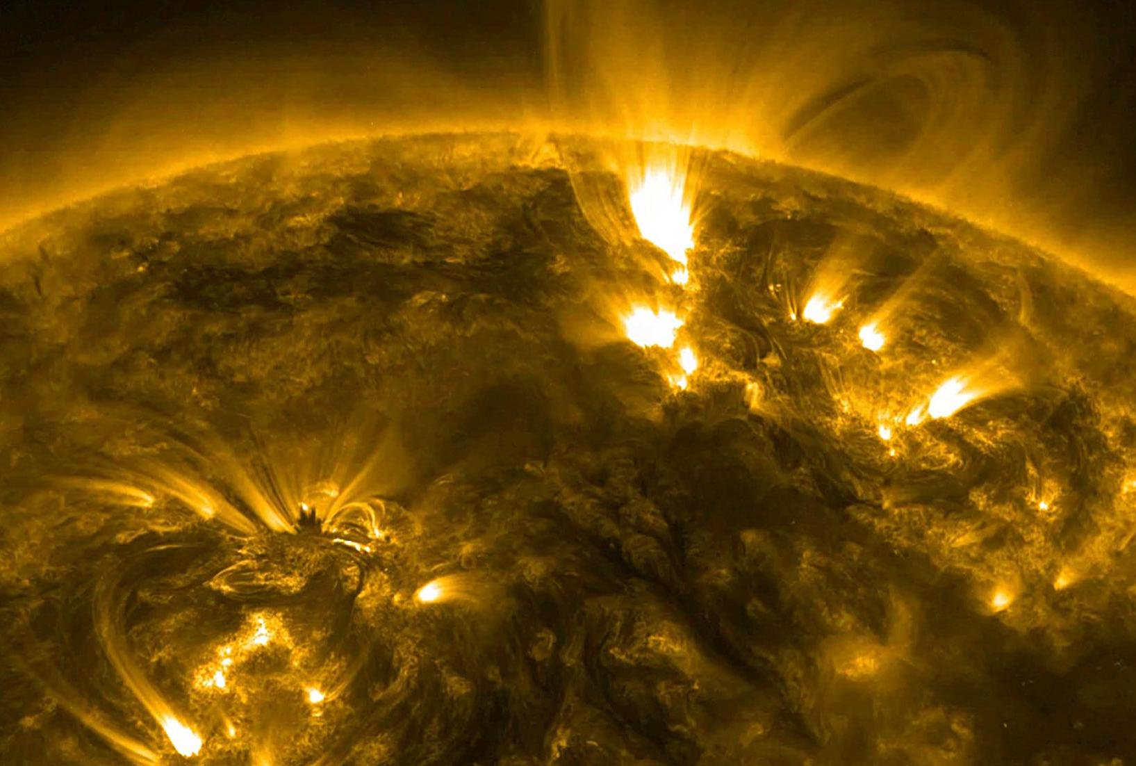 swirling plumes of gas above the surface of the Sun