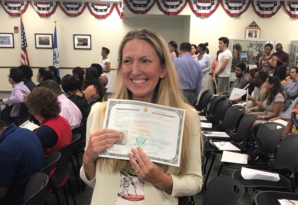 Woman getting U.S. citizenship certificate