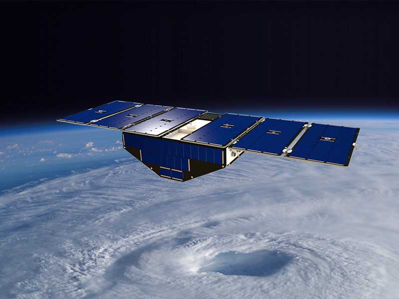 Illustration of Spacecraft in orbit about hurricane.