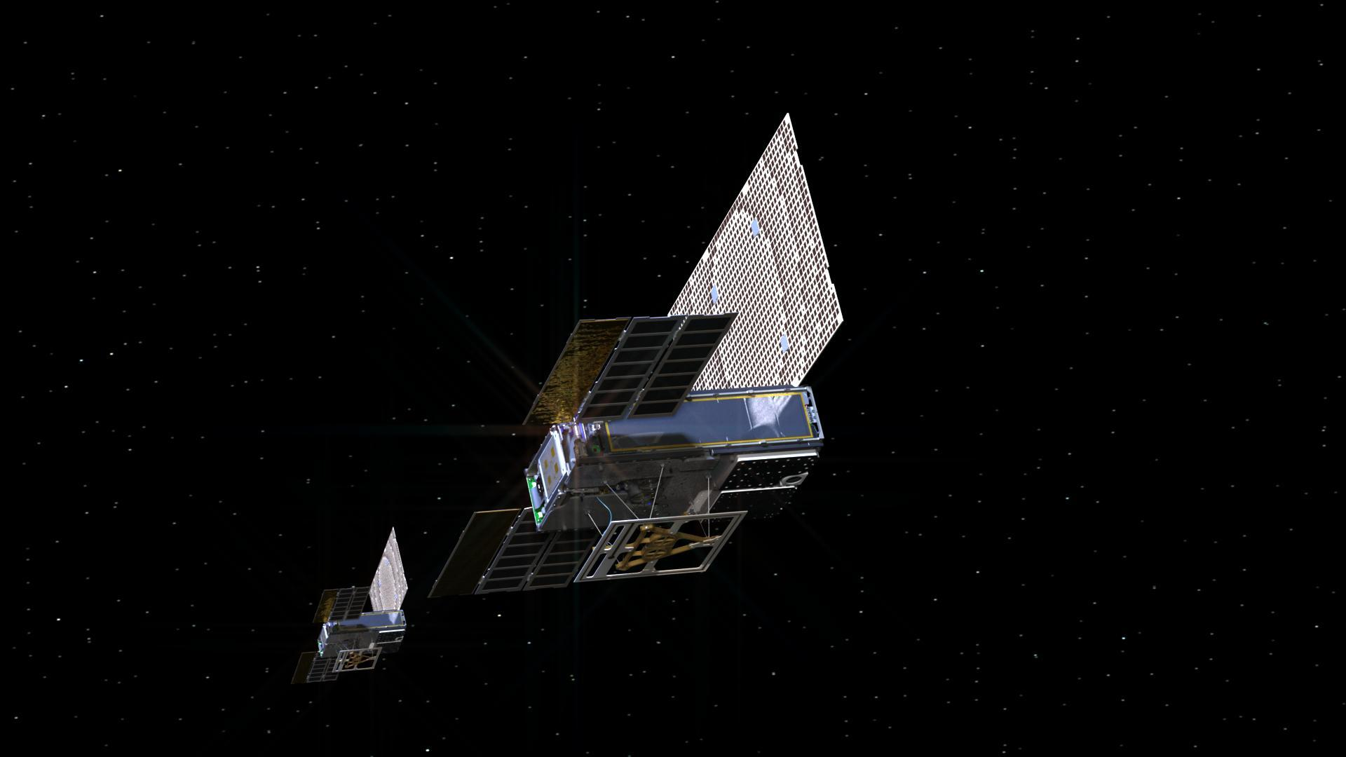Twin small spacecraft in space.