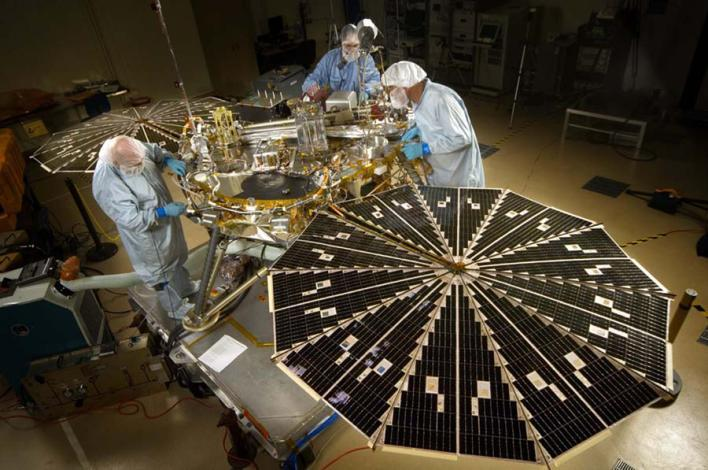 Engineers working on spacecraft.