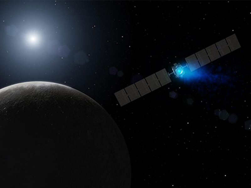 An artist's concept of Dawn, propelled by ion propulsion, approaching Ceres.