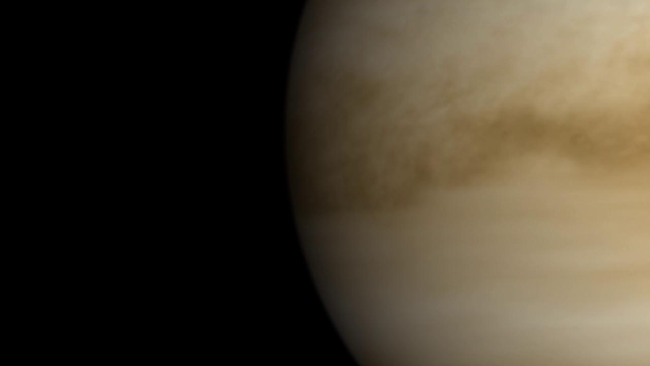 slide 5 - Image of planet cloaked in thick, brownish clouds.