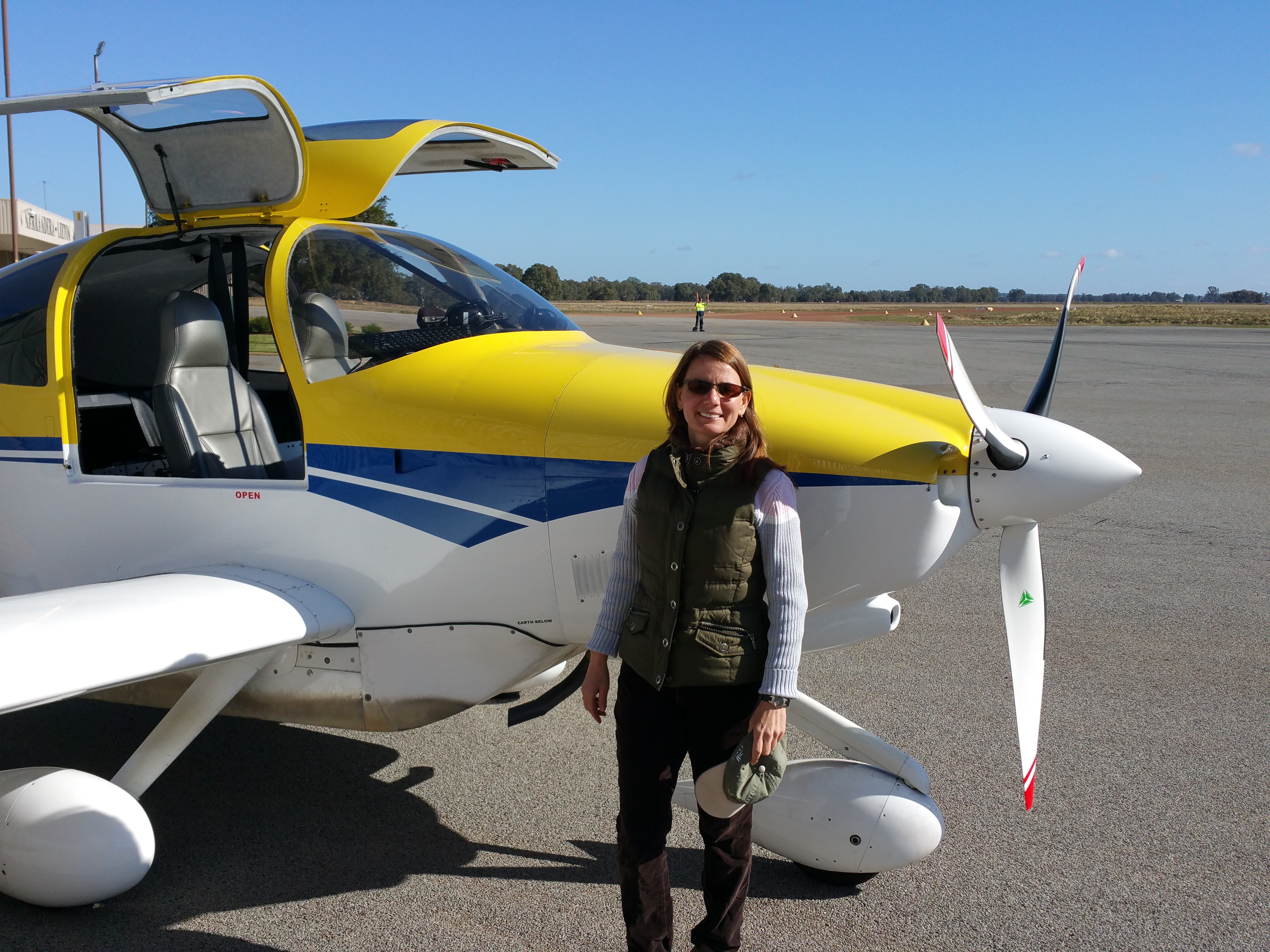 At a Soil Moisture Active Passive (SMAP) campaign in Australia, posing in front of an aircraft that collected measurements in support of the calibration/validation activities. Credit: Erika Podest