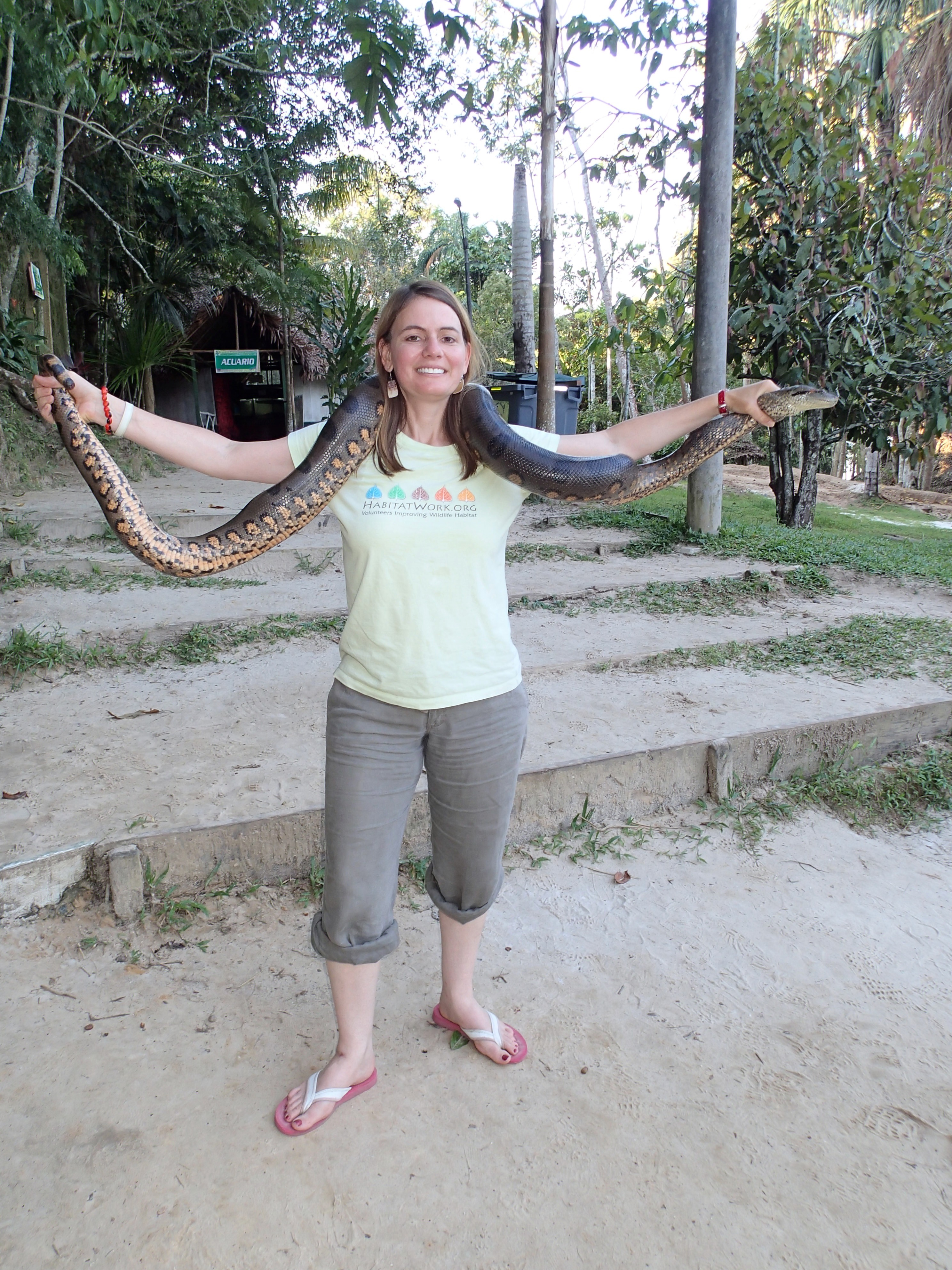 Posing with an Anaconda in the Peruvian Amazon. Credit: Erika Podest