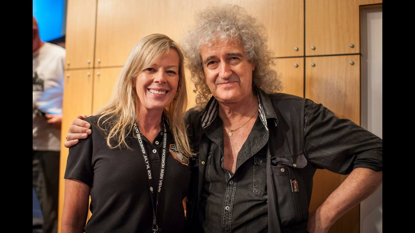 With Queen guitarist and astrophysicist Brian May at Pluto flyby
