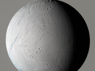 This false-color view, made on a previous flyby, shows that unlike other Saturn moons, the surface of Enceladus consists of entire regions that appear to be relatively crater-free.