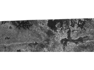 Lakes and More Lakes: In this image taken by the Cassini radar system on Oct. 9, 2006, a previously unseen style of lakes is revealed. The lakes here assume complex shapes and are among the darkest seen so far on Titan.