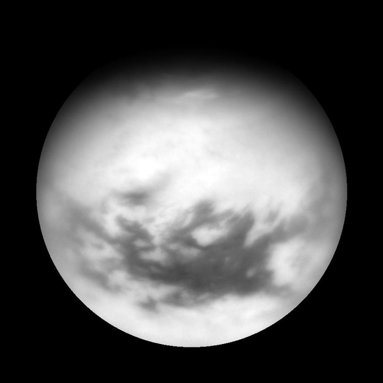 Titan's equatorial dark regions are visible in this view, along with faint, dark lineaments (linear features) in the otherwise bland-looking terrain of the north. Image taken April 13, 2007.