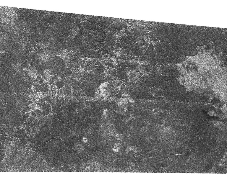Fluids have flowed and cut these deeply-incised channels into the icy surface of Titan as seen in this Synthetic Aperture Radar image. This Cassini radar image was acquired as a part of the Titan flyby observations taken on Sept. 7, 2005, from a distance of about 2,000 kilometers (1,250 miles).