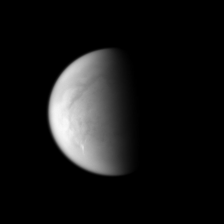 Cloud streaks stand out on Saturn's largest moon, Titan.  The tropospheric clouds seen in the lower left of the image are located at 45 to 55 degrees south latitude on Titan, and the streaks of the clouds are oriented east-west. This view looks toward the south pole of Titan.