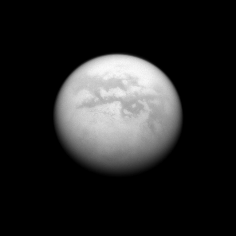 The Cassini spacecraft charts a quartet of dark albedo features on the moon Titan. From upper left to lower right of the image are Fenzal, Aztlan, Aaru and Senkyo. Image taken June 9, 2009.