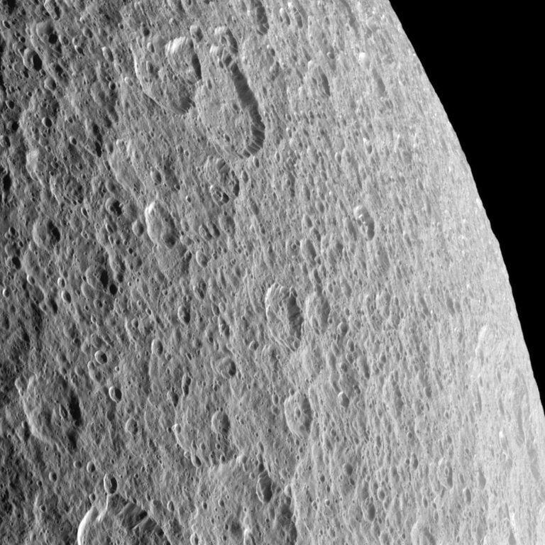 Craters imprinted upon other craters record the long history of impacts endured by Saturn's moon Rhea. The image was taken in visible light with the Cassini spacecraft narrow-angle camera on Oct. 13, 2009.