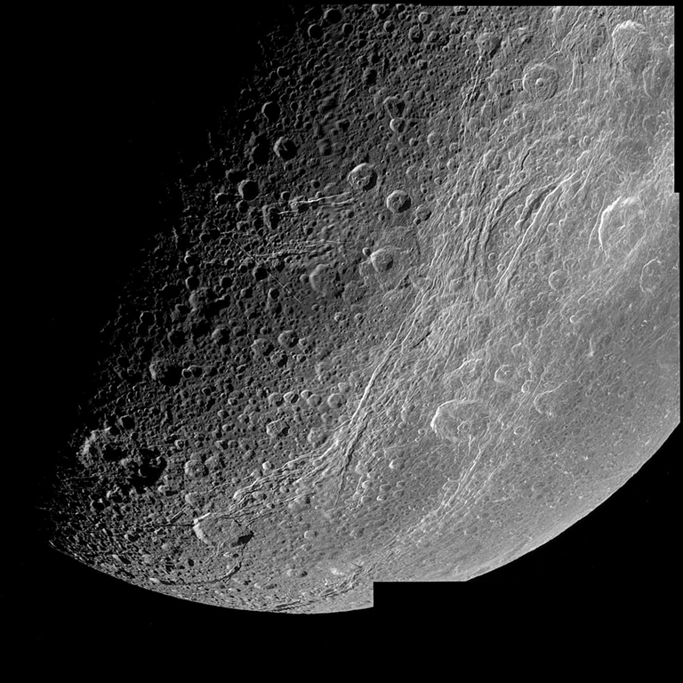 This very detailed image taken during the Cassini spacecraft's closest approach to Saturn's moon Dione on Dec. 14, 2004 is centered on the wispy terrain of the moon.