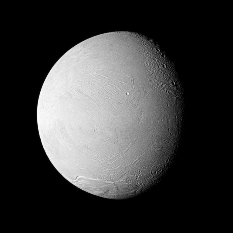 The Cassini spacecraft examines old and new terrain on Saturn's fascinating Enceladus, a moon where jets of water ice particles and vapor spew from the south pole. This image was captured during Cassini's Nov. 21, 2009, flyby of the moon