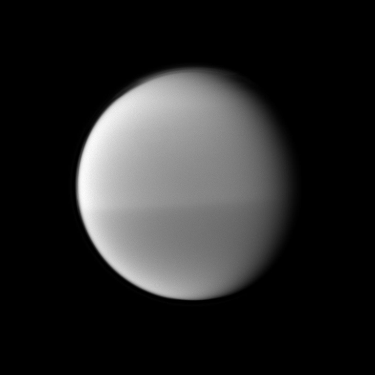 The Cassini spacecraft examines Titan's dark and light seasonal hemispheric dichotomy as it images the moon with a filter sensitive to near-infrared light. This image was taken May 22,2010.