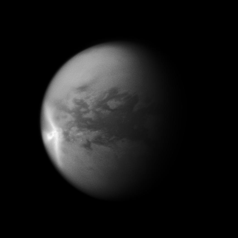 A huge arrow-shaped storm blows across the equatorial region of Titan in this image from NASA's Cassini spacecraft, chronicling the seasonal weather changes on Saturn's largest moon. This image is a mosaic of two Cassini images. Most of this view is from an image of the storm captured on Sept. 27, 2010. However, because that image's framing cut off the south polar region of the moon, a second image taken on July 9, 2010, was used to fill in that portion of the moon.