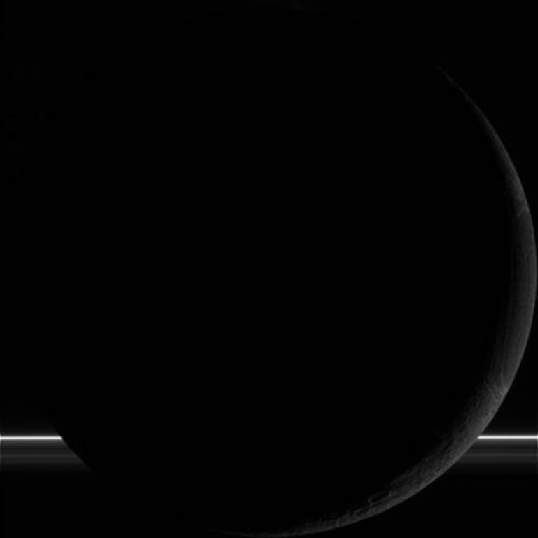 NASA's Cassini spacecraft successfully completed its Oct. 1 flyby of Saturn's moon Enceladus, capturing this raw, unprocessed image of the moon.