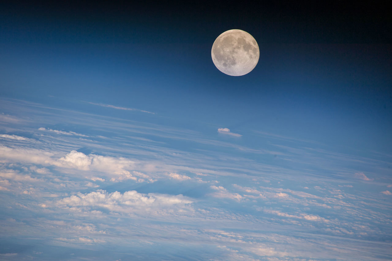 Full Moon rises over Earth as seen from International Space Station.