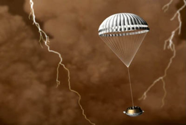 Huygens probe descending through Titan's atmosphere. Image Credit: ESA