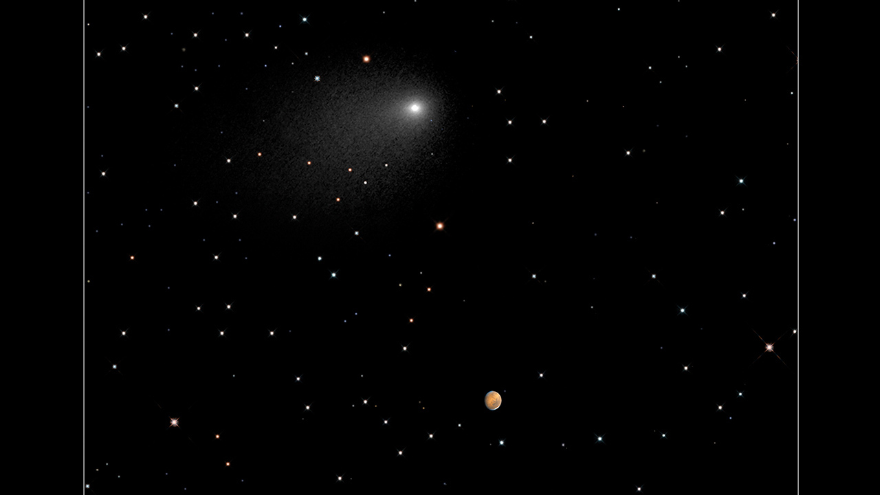 This composite Hubble Space Telescope image captures the positions of Comet Siding Spring and Mars in a never-before-seen close passage of a comet by the Red Planet, which happened at 2:28 p.m. EDT October 19, 2014.
