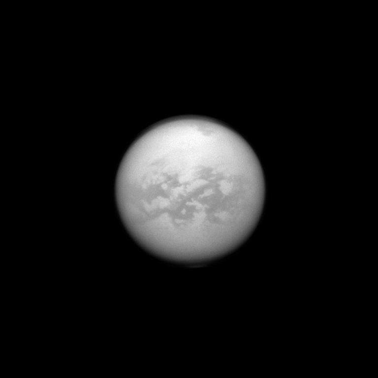 The Cassini spacecraft once again dons its special infrared glasses to peer through Titan's haze and monitor its surface. Here, Cassini has recaptured the equatorial region dubbed 'Senkyo.' The dark features are believed to be vast dunes of hydrocarbon particles that precipitated out of Titan's atmosphere. Image released Oct. 28, 2013.