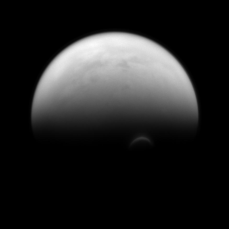 The sunlit edge of Titan's south polar vortex stands out distinctly against the darkness of the moon's unilluminated hazy atmosphere. The Cassini spacecraft images of the vortex led scientists to conclude that its clouds form at a much higher altitude - where sunlight can still reach - than the surrounding haze. Image released Dec. 2, 2013.