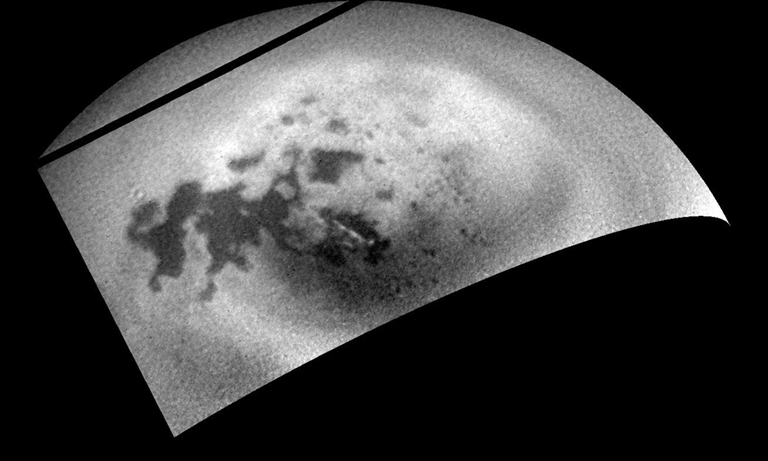 As the Cassini spacecraft sped away from Titan following a relatively close flyby, its cameras monitored the moon's northern polar region, capturing signs of renewed cloud activity. Image released Aug. 12, 2014