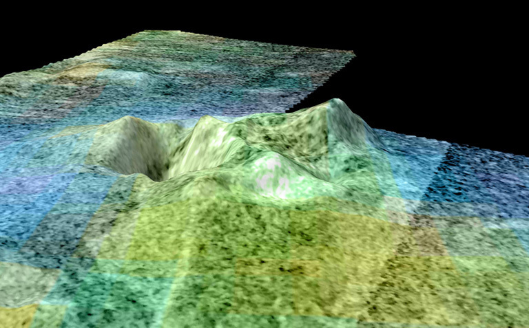 Still frame from a movie based on data from NASA's Cassini spacecraft and shows a flyover of an area of Saturn's moon Titan known as Sotra Facula. Scientists believe Sotra is the best case for an ice volcano -- or cryovolcano -- region on Titan.
