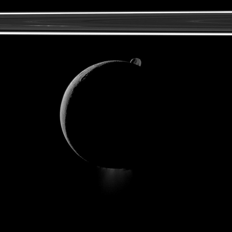 During a flyby of Saturn's moon Enceladus on Oct. 1, 2011, the Cassini spacecraft snapped this portrait of the moon joined by its sibling Epimetheus and the planet's rings.
