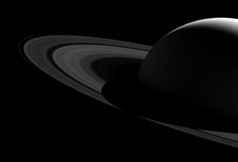A black and white image of Saturn and its magnificent rings