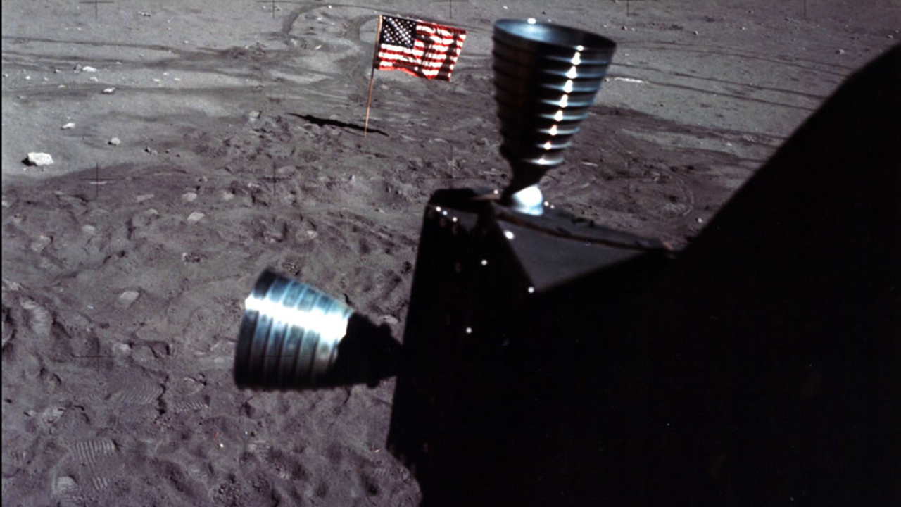 Color image of rocket engines on the surface of the moon.