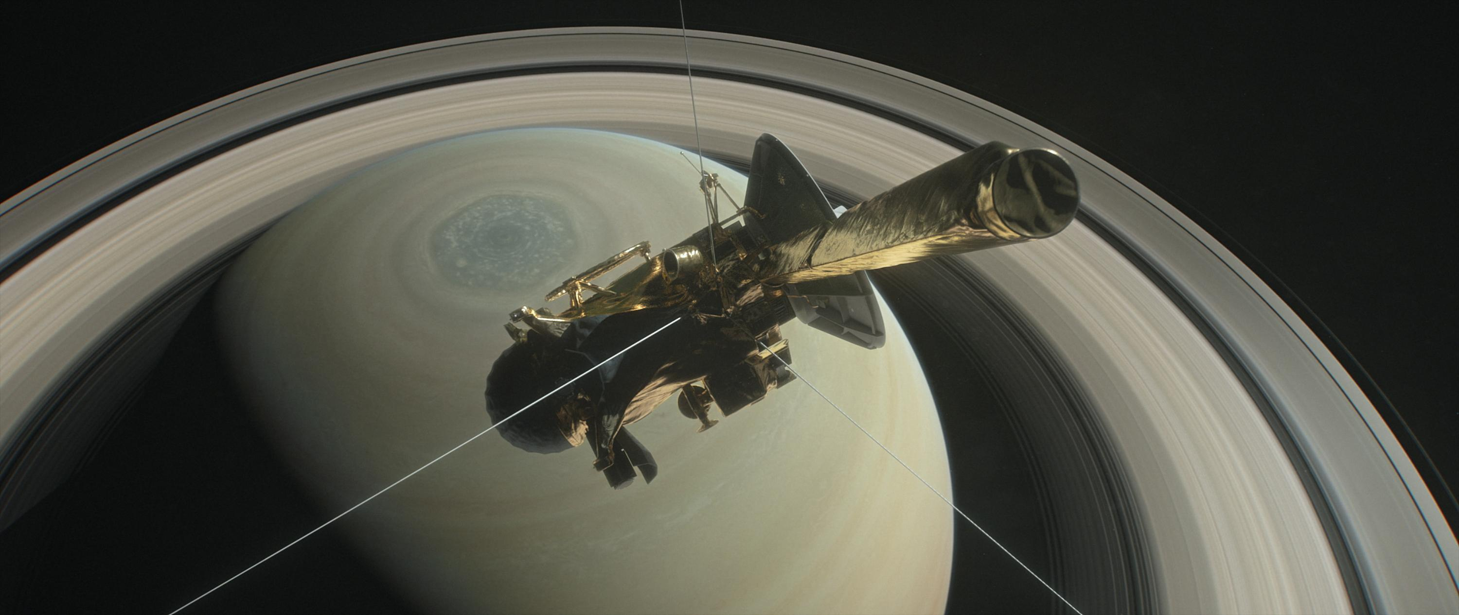 NASA's Cassini spacecraft is shown heading for the gap between Saturn and its rings during one of 22 such dives of the mission's finale in this illustration. The spacecraft will make a final plunge into the planet's atmosphere on Sept. 15.