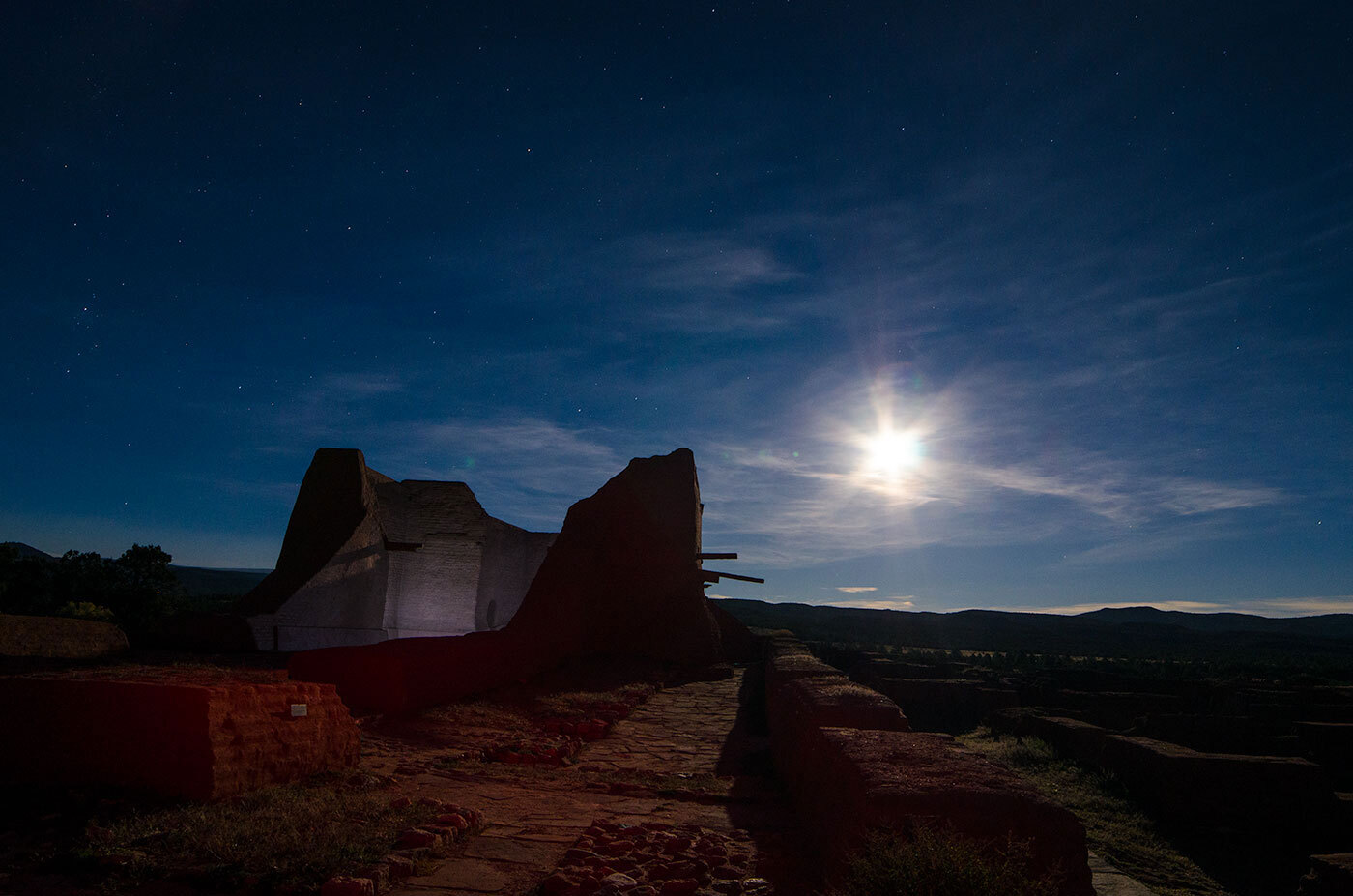 A bright Moon lights up the ruins of an old Spanish mission in New Mexico.