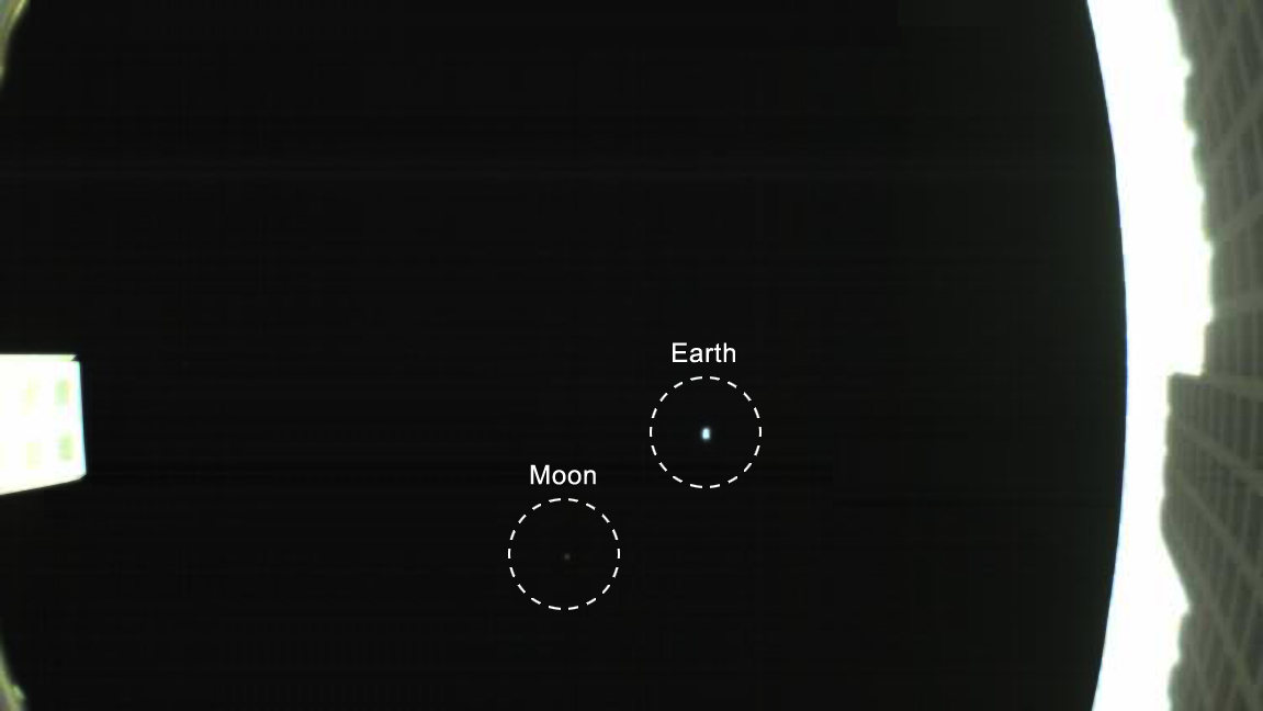 The CubeSat's unfolded high-gain antenna at right and the Earth and its moon in the center.