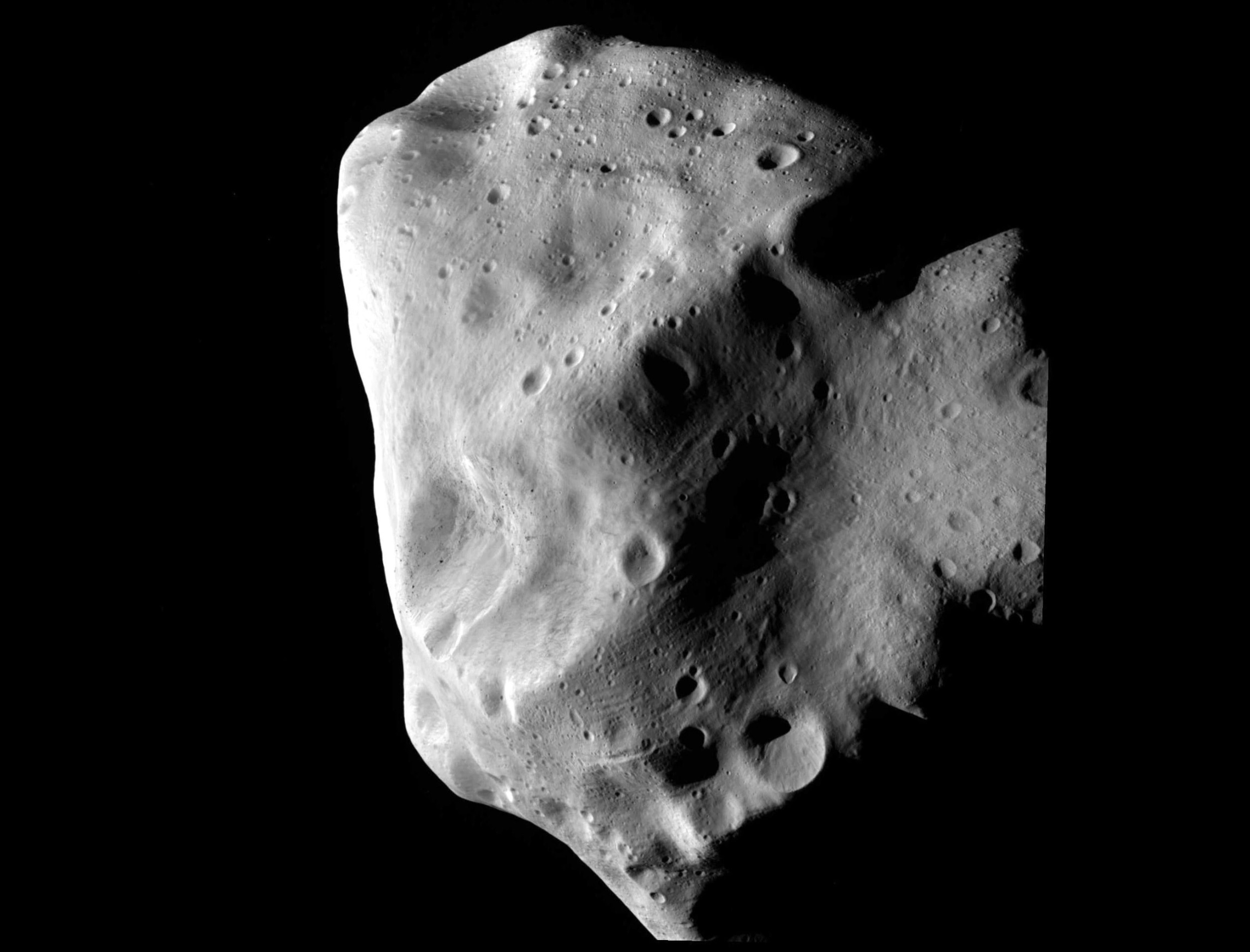 lumpy asteroid in blackness of space