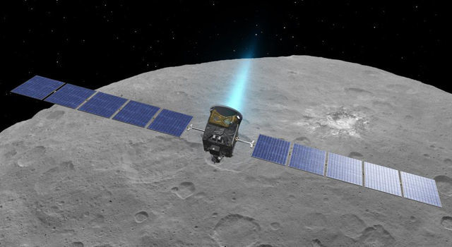 This artist concept shows NASA's Dawn spacecraft above dwarf planet Ceres, as seen in images from the mission.