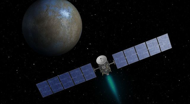 This artist's concept shows NASA's Dawn spacecraft heading toward the dwarf planet Ceres.