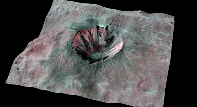 This composite-color view from NASA's Dawn mission shows Cornelia Crater, streaked with dark materials, on the giant asteroid Vesta.