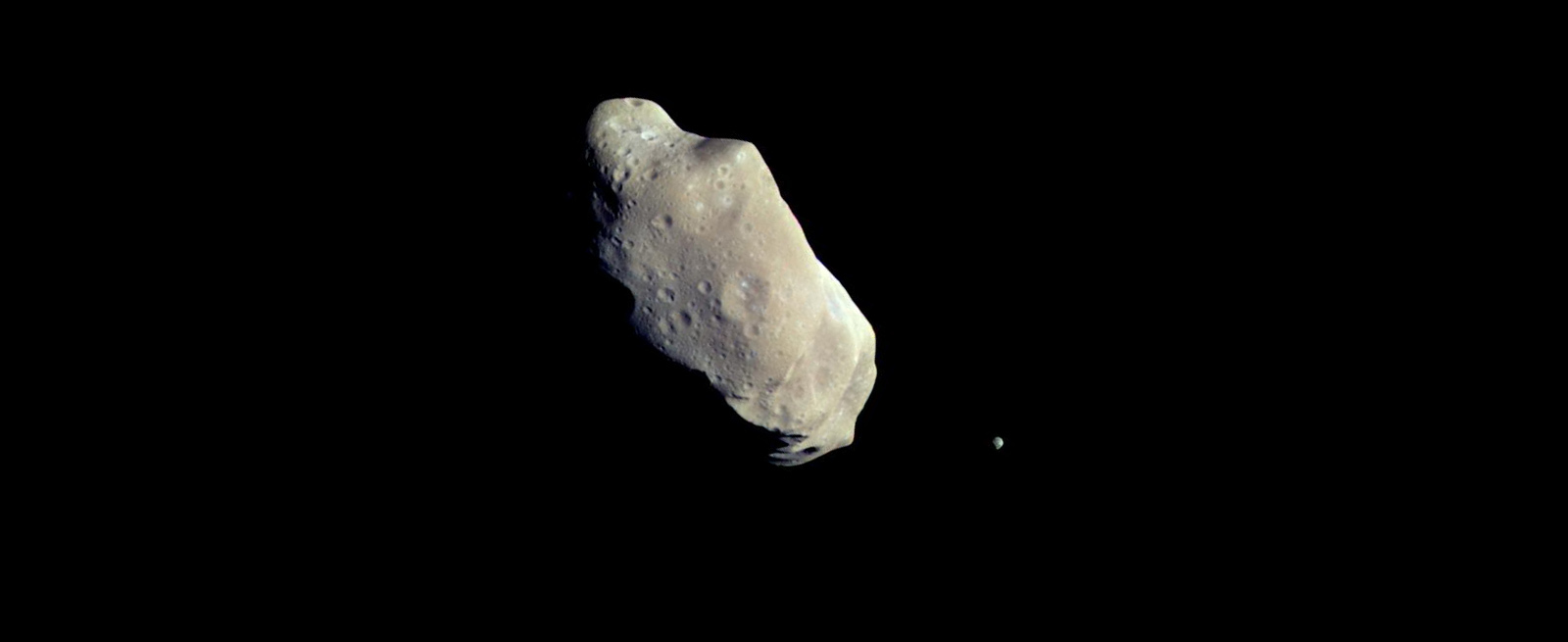 two rocky asteroids in black space