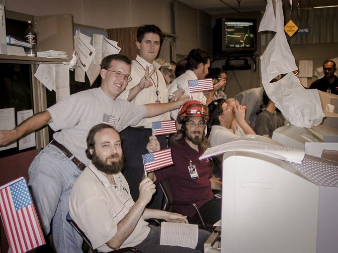 flag-waving engineers in mission control