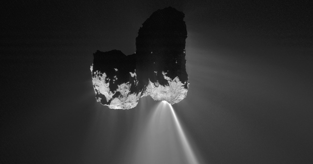 comet nucleus and bright jet of material spewing out