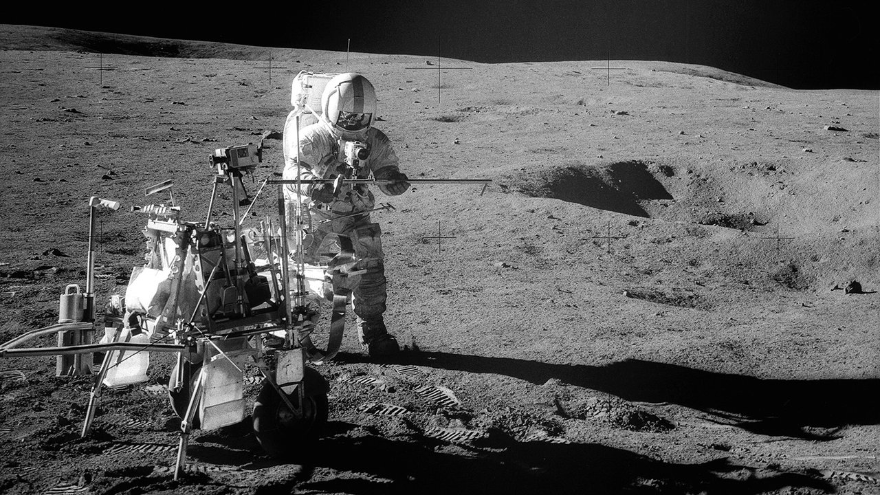 Apollo 14 Astronaut Alan B. Shepard Jr. assembles equipment on the lunar surface in Feburary 1971. Credit: NASA  Full Image and Caption ›