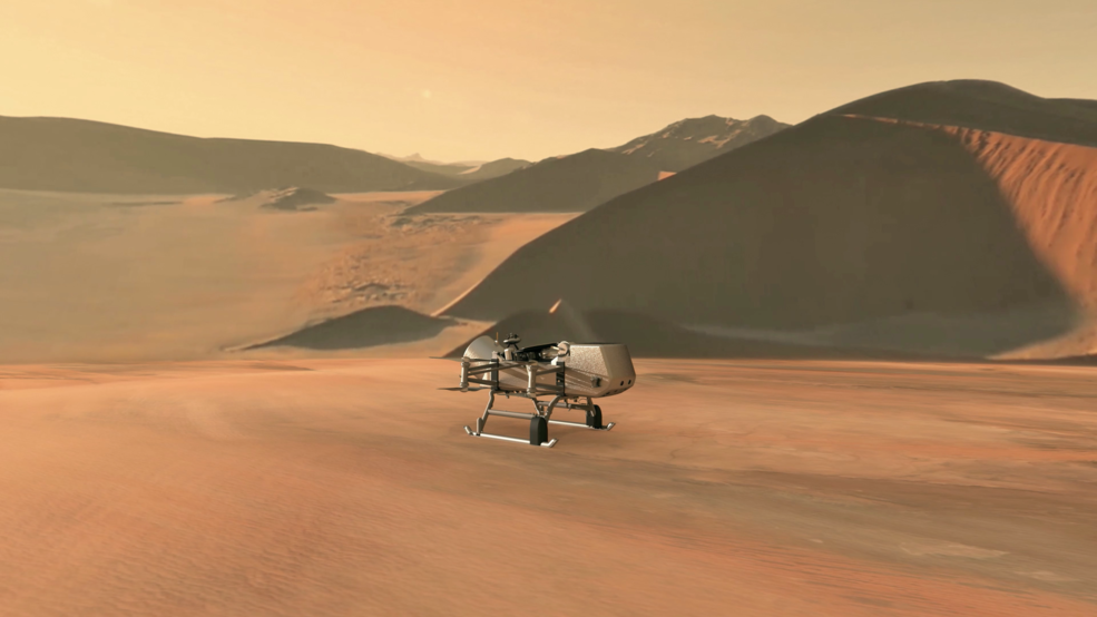 robotic spacecraft flying through field of large dunes