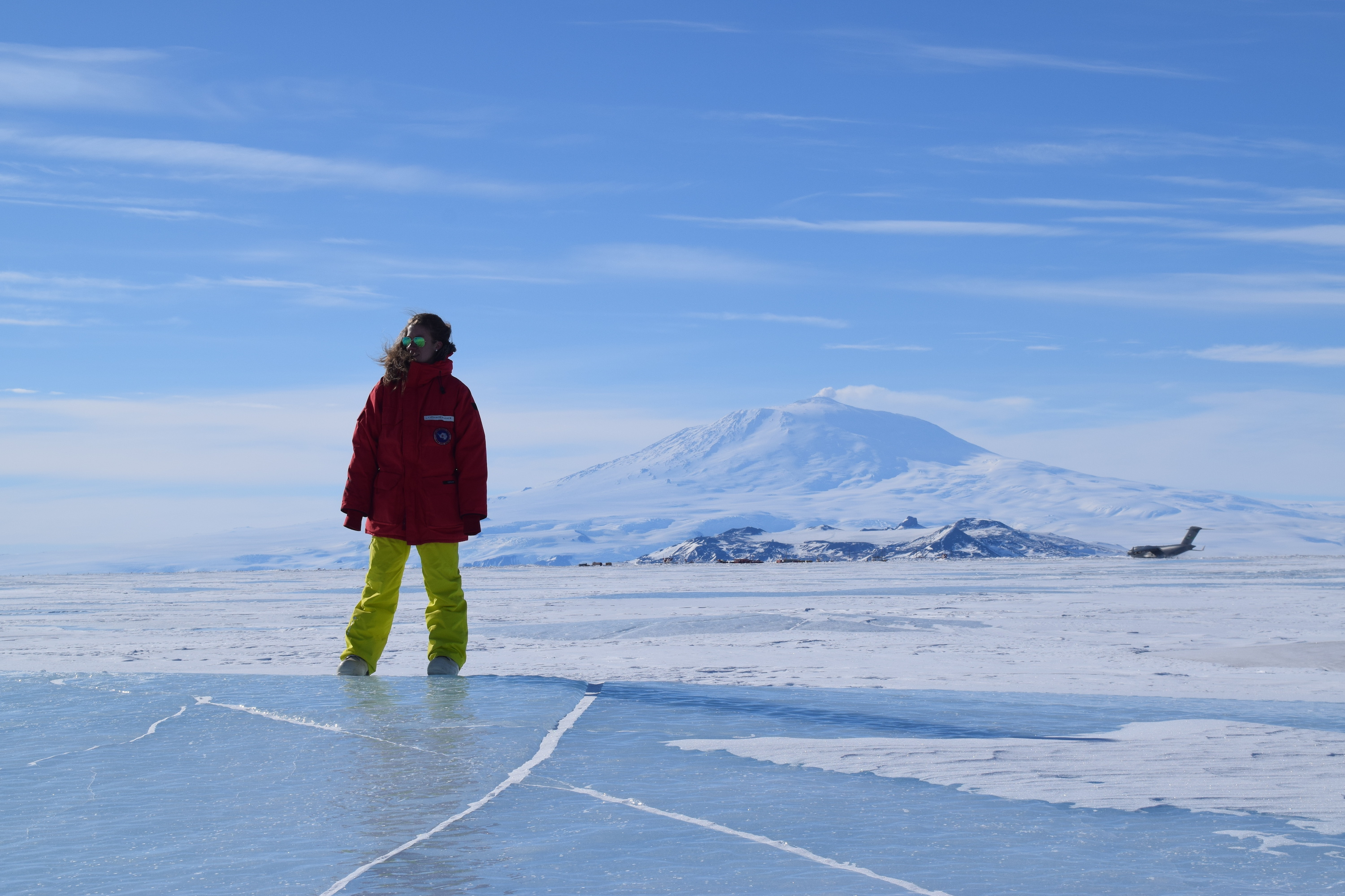woman standing on icy plain