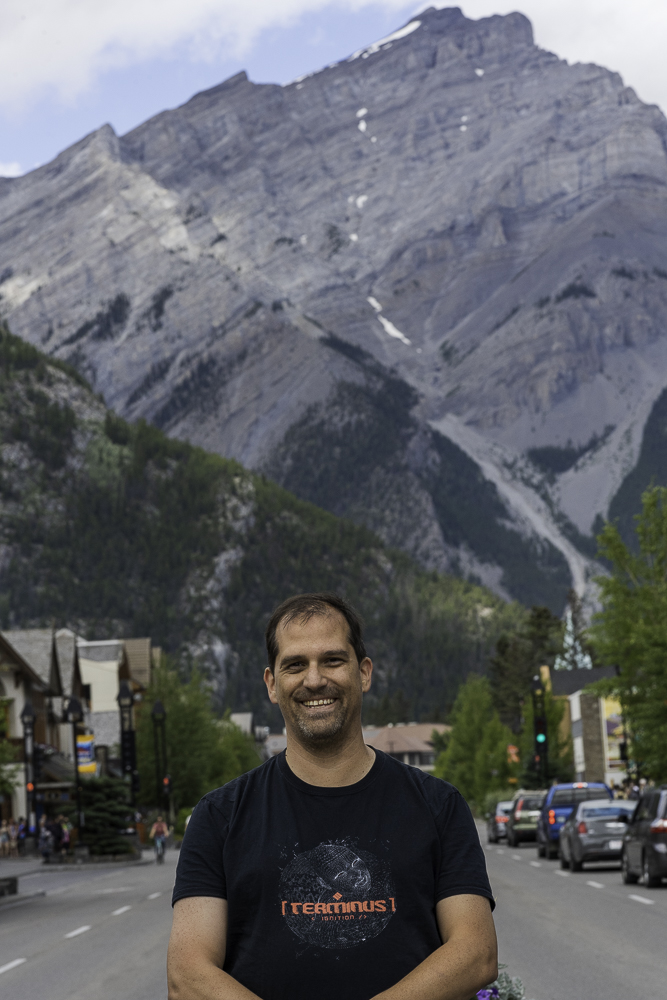 image of smiling man in street with mountains in the background