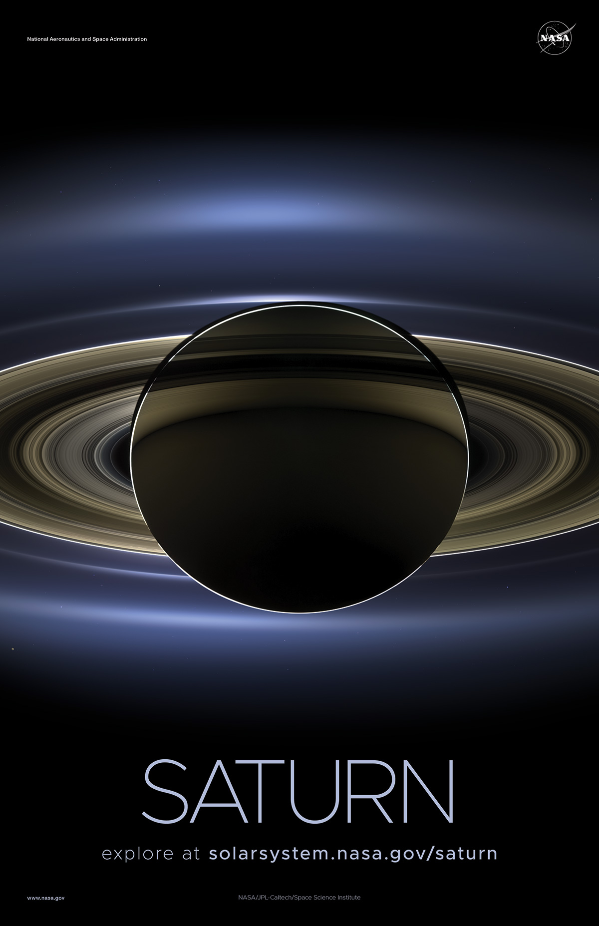 Saturn and its rings backlit by the Sun.