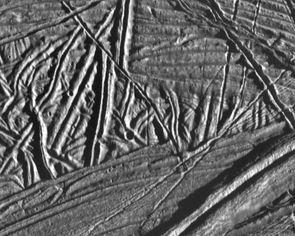This high resolution image of the icy crust of Europa, one of Jupiter's moons, reveals a surface criss-crossed by multiple sets of ridges and fractures.