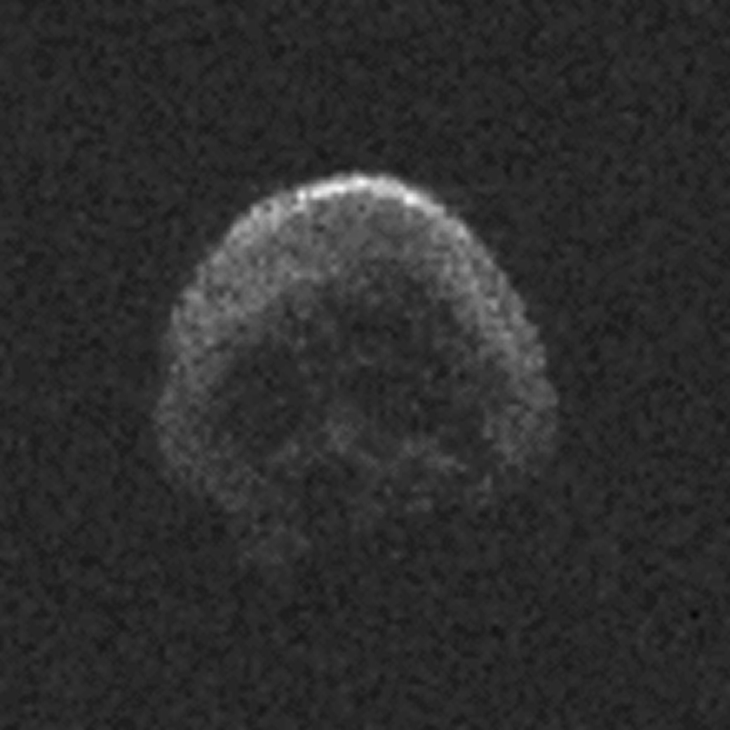 grainy radar image of asteroid that resembles a human skull