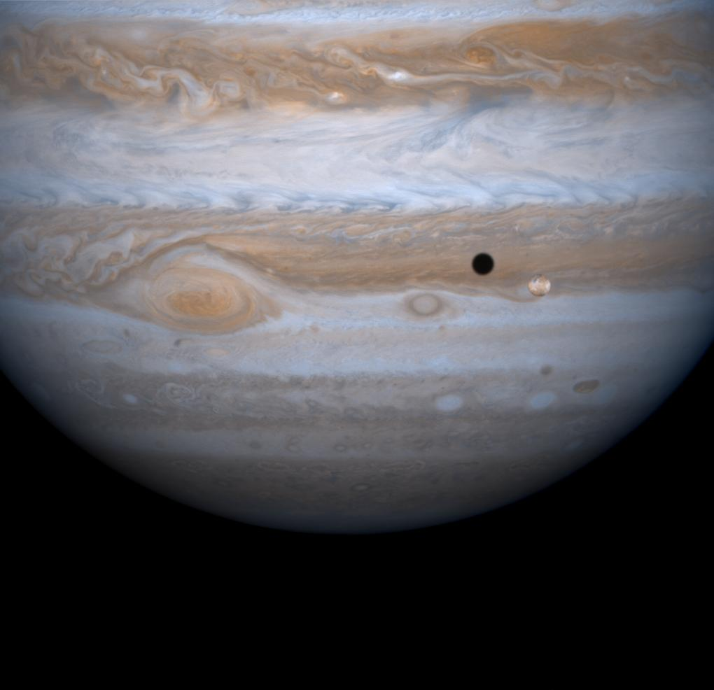 Jupiter's four largest satellites, including Io, the golden ornament in front of Jupiter in this image from NASA's Cassini spacecraft, have fascinated Earthlings ever since Galileo Galilei discovered them in 1610 in one of his first astronomical uses of the telescope.